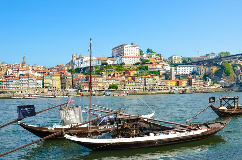 Porto, Portugal - August 31 2018: Traditional wooden boats used for wine barrel transport on river Douro. Historical old town in royalty free stock photos