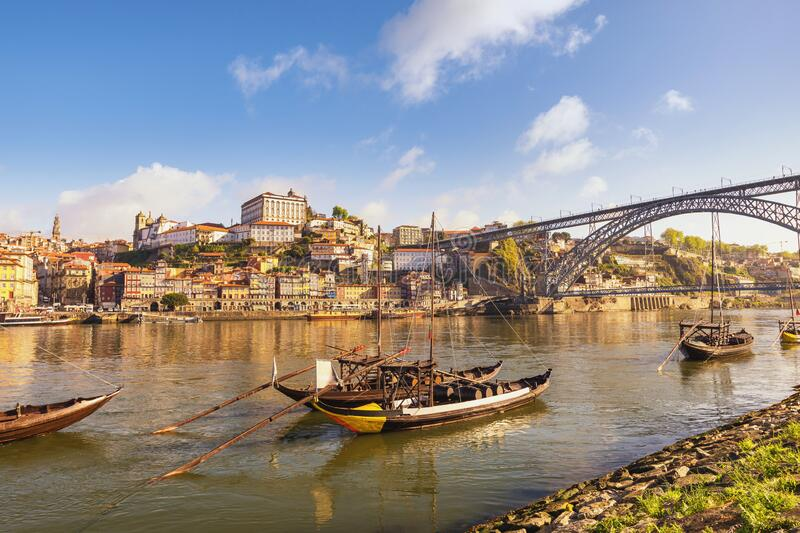Porto Portugal city skyline at Ribeira and Douro River with Rabelo wine boat royalty free stock photography