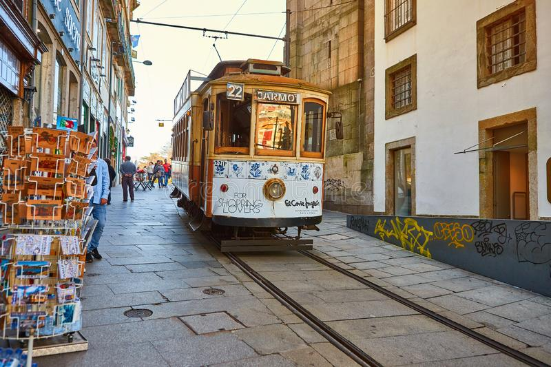 PORTO, PORTUGAL, 09, December, 2018: Wooden historical vintage street tram moving through Porto, symbol of city. Indispensable. PORTO, PORTUGAL, 09, December royalty free stock image