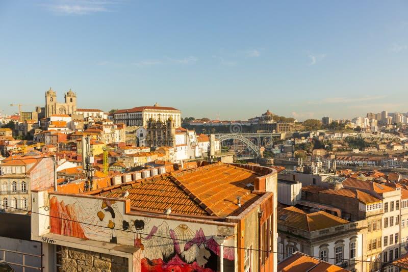 Famous Porto bridge Ponte Luis. Porto with bridge, church and brick red roofs. Porto landmark on sunny day. stock photo