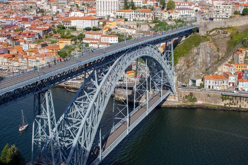 Famous Porto bridge Ponte Luis top view. Porto bridge over river Douro. Portuguese river Douro with metro bridge and tourists. stock photos