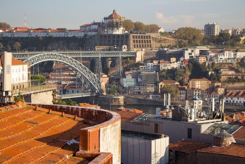 Famous Porto bridge Ponte Luis. Porto with bridge, church and brick red roofs. Porto landmark on sunny day. royalty free stock images