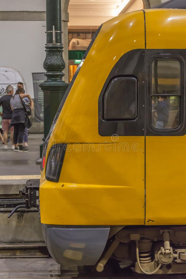 Front view at the train, on interior of the St. Bento rail station, in the city of Porto. Porto/Portugal - 10 04 2018:Front view at the yellow train, on interior stock photos