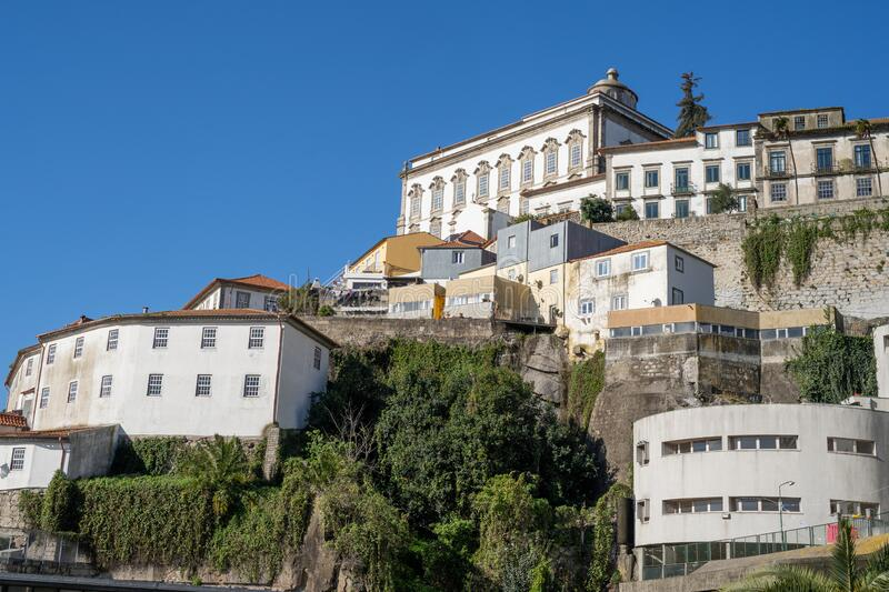 Porto, Portugal - January 20, 2020: Colorful buildings in the Ribeira district, Porto`s historical area overlooking the Douro. River and Vila Nova de Gaia royalty free stock photos