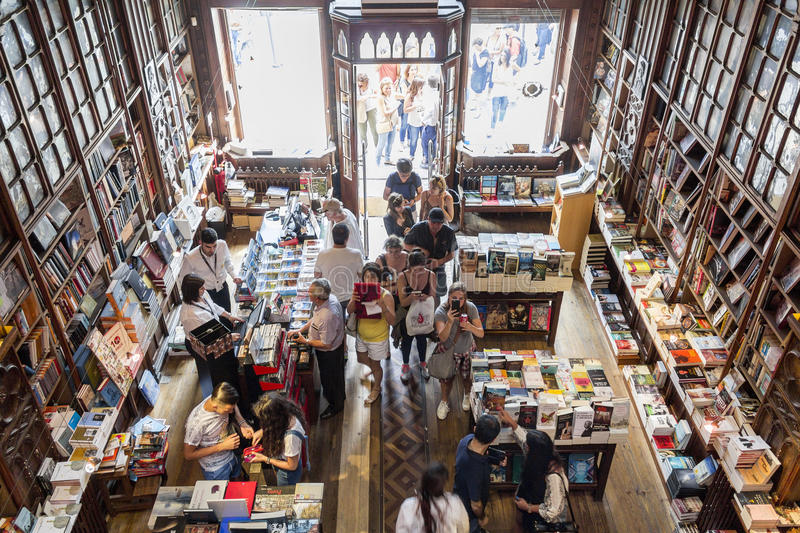 PORTO, PORTUGAL - JULY, 04: People visiting famous bookstore. Livraria Lello, establishment in 1919 it is one of the oldest bookstores in Portugal, on July 04 royalty free stock images