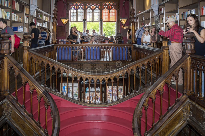 PORTO, PORTUGAL - JULY, 04: People visiting famous bookstore. Livraria Lello, establishment in 1919 it is one of the oldest bookstores in Portugal, on July 04 royalty free stock photography