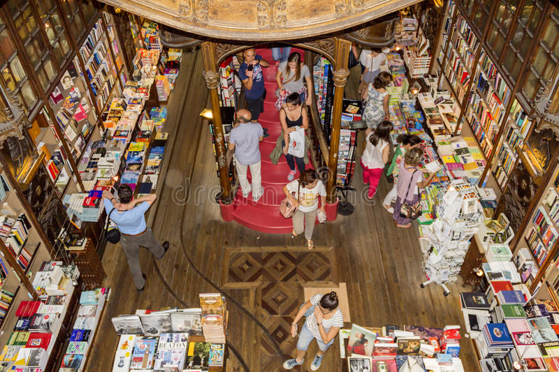 PORTO, PORTUGAL - JULY, 04: People visiting famous bookstore. Livraria Lello, establishment in 1919 it is one of the oldest bookstores in Portugal, on July 04 stock photos