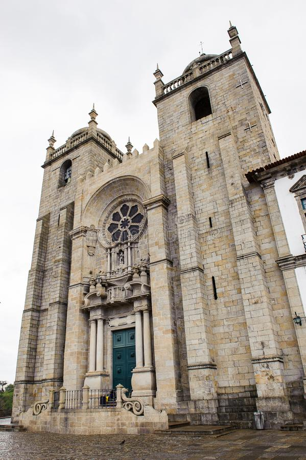 Architecture of Porto, Portugal. PORTO, PORTUGAL - JUN 21, 2014: Cathedral of the Assumption of Our Lady (Porto Cathedral), one of the most important Romanesque royalty free stock images