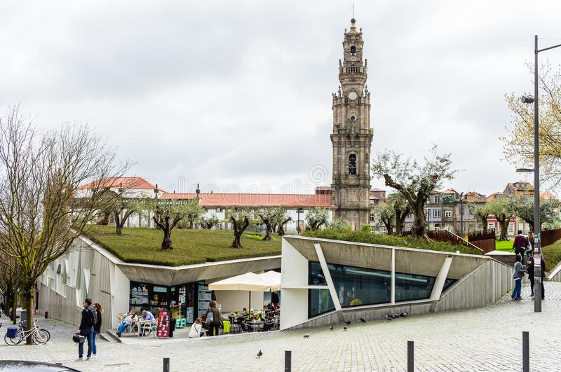 Lisboa Square market and Clerigos church tower in Porto, Portuga. PORTO, PORTUGAL - MARCH 11, 2017: Lisboa Square modern market building and Clerigos baroque royalty free stock photos
