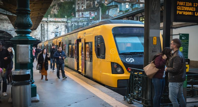 Interior of Porto train station where people walk on the dock royalty free stock images