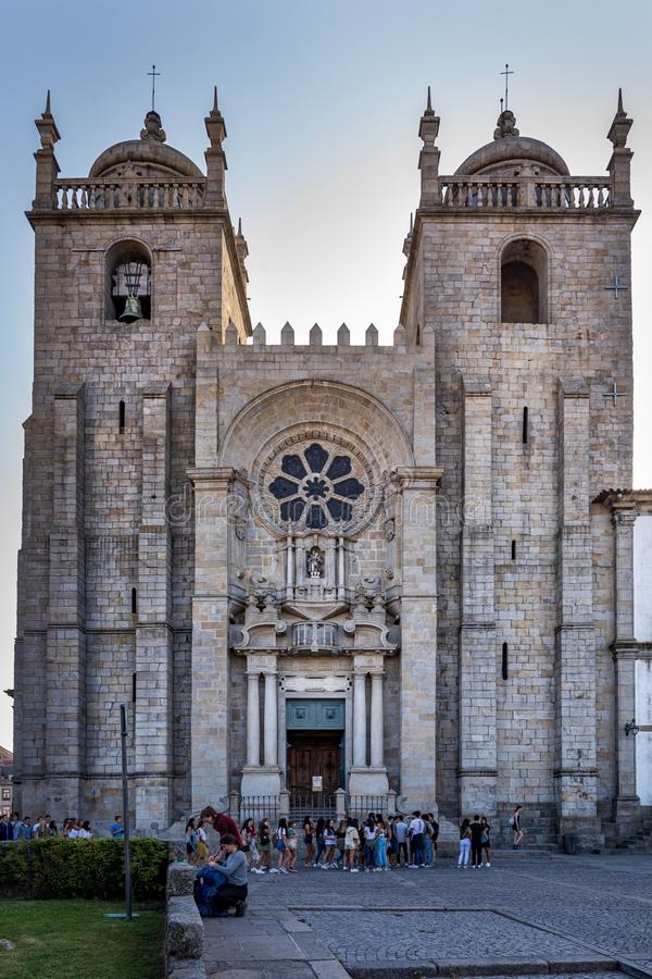 Porto, Portugal - September 13, 2019 - Early morning crowd at the main entrance to the Se Cathedral in Porto, Portugal. Porto, Portugal - September 13, 2019 stock photo