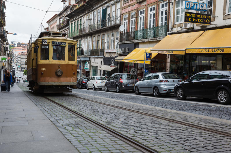 Download Porto, Portugal  Street Featuring An Old Brown And Tan Trolley On Ancient Cobblestones With A Row Modern Cars Editorial Stock Image - Image: 28203829