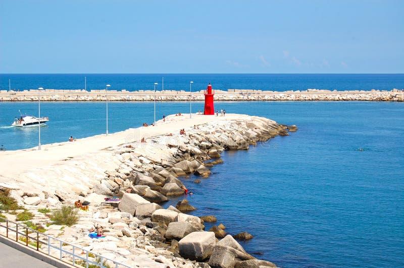 Port of trani blue sea white rocks stock photo