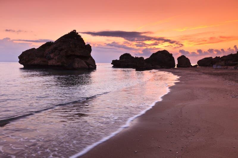 Porto Zoro beach sunrise stock photo