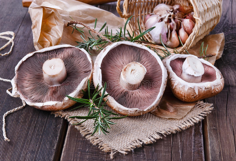 Portobello mushrooms over rustic wooden background royalty free stock photo