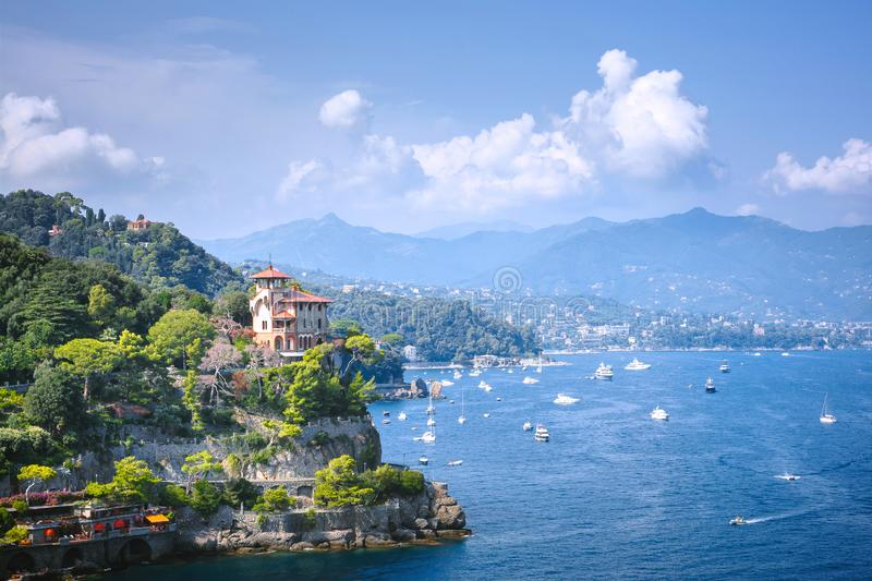 Portofino, Liguria, Italy - aug 09, 2018: Beautiful aerial daylight view from top to boats on water, colorful houses, mountains . stock photography