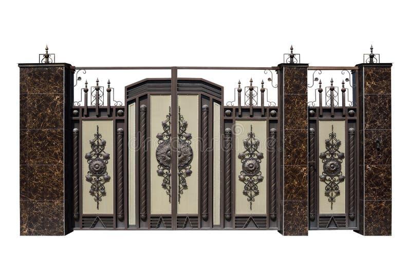 Portoni e porta forgiati con la decorazione fotografie stock libere da diritti