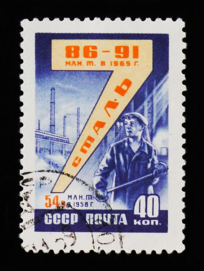 Portostämpeln ägnade till stålproduktion, circa 1958 royaltyfri bild