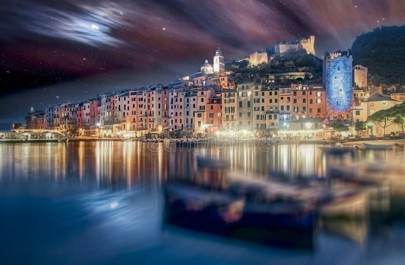 Portovenere, Italy at twilight with reflections stock images