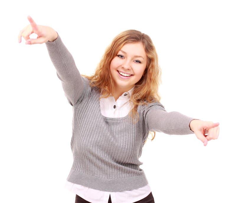 Porträt der aufgeregten jungen Frau, die auf Sie zeigt   lizenzfreie stockbilder