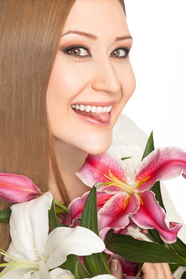 Lächelnde Zunge Frau xxl Lilien stockfoto