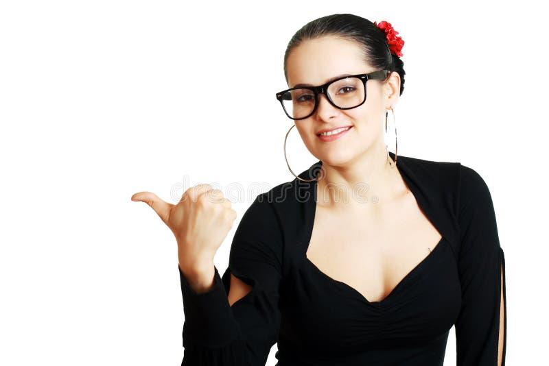 Lächelnfrauenzeigen stockfoto