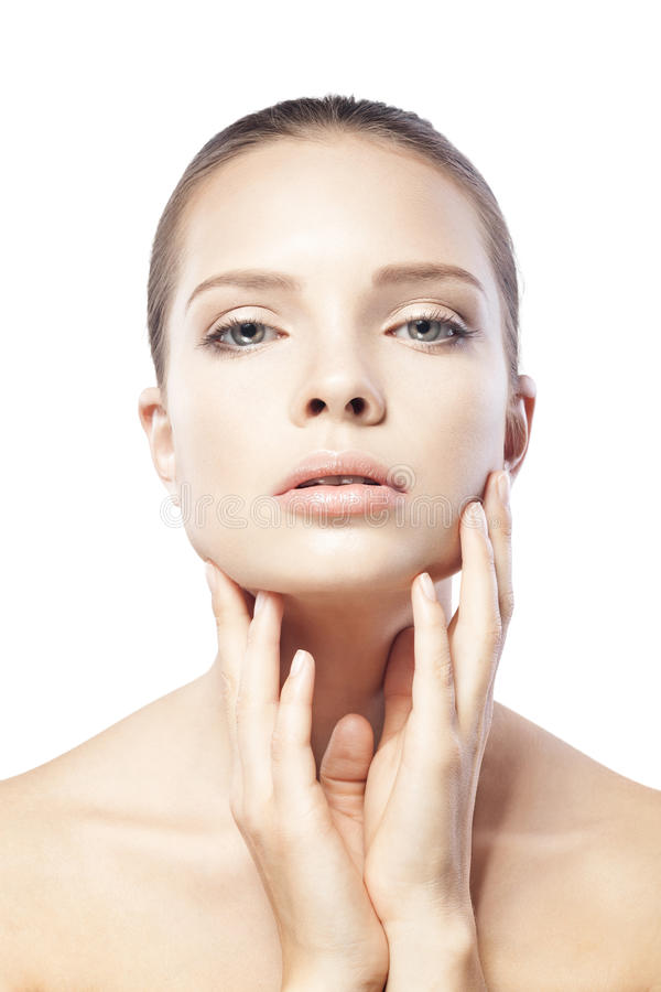 Porträt der schönen jungen Frau mit der sauberen Haut lokalisiert stockfotos