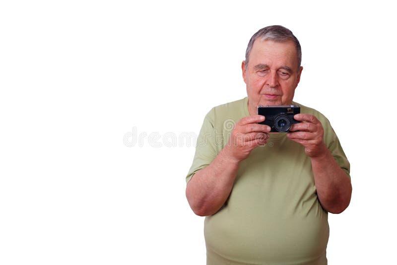 Porträt des älteren älteren erfüllten Mannes, der Foto mit macht, rösten lizenzfreie stockbilder