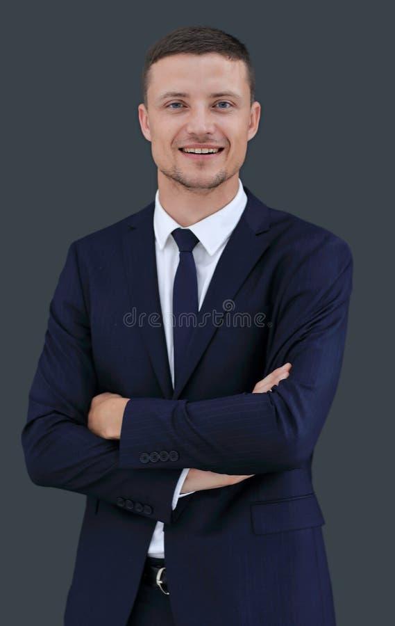 Porträt des glücklichen Geschäftsmannes lokalisiert auf einem dunklen Hintergrund stockfotos