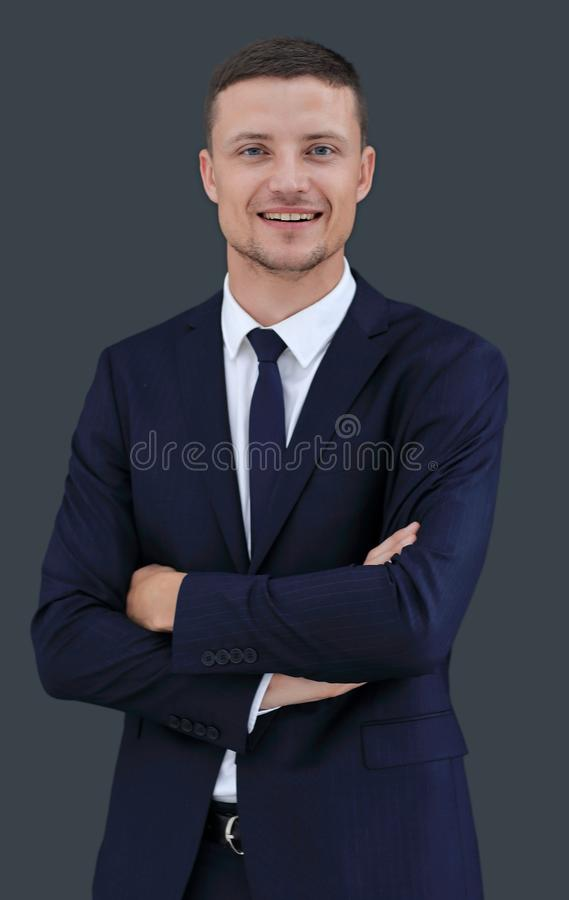 Porträt des glücklichen Geschäftsmannes lokalisiert auf einem dunklen Hintergrund lizenzfreie stockbilder