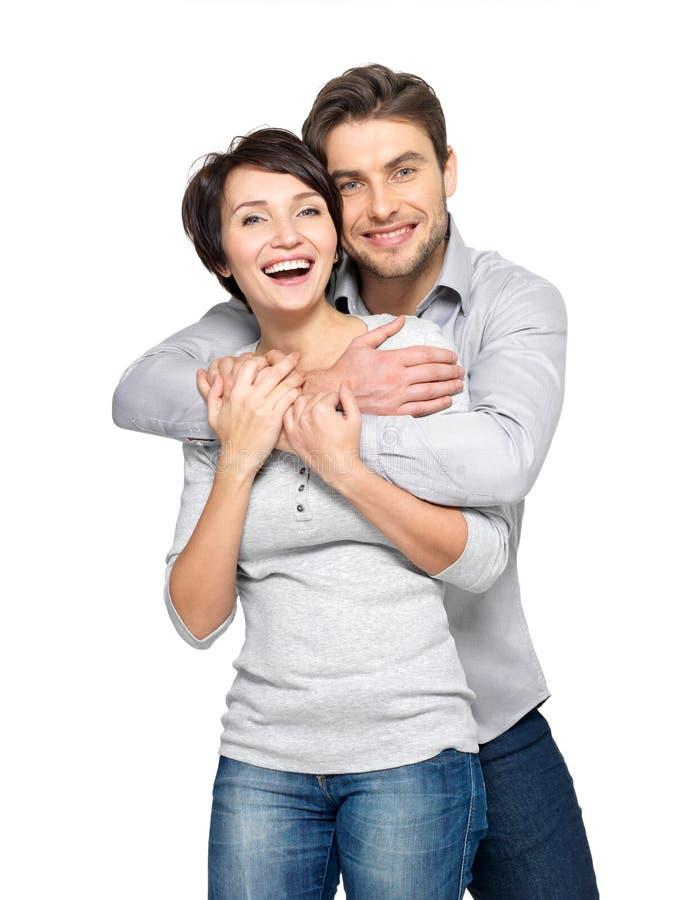 Porträt des glücklichen Paars getrennt auf Weiß stockfotos