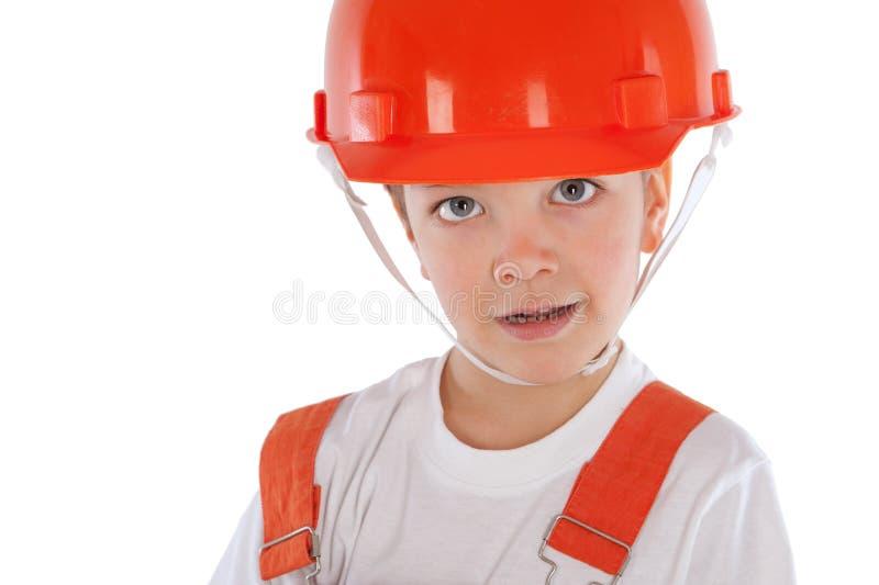 Porträt des Jungen im orange Sturzhelm, Isolierung lizenzfreie stockfotos