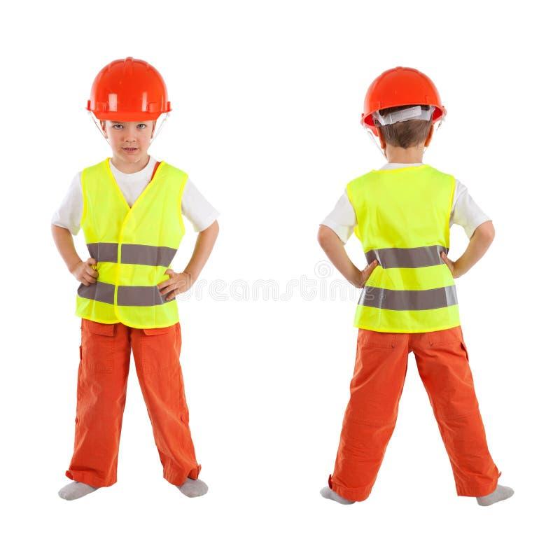 Porträt des Jungen im orange Sturzhelm, Isolierung lizenzfreie stockfotografie