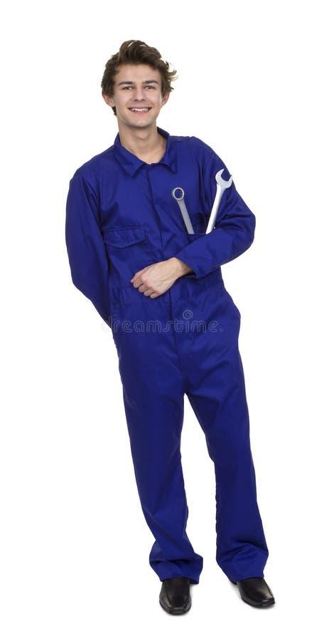 Porträt des jungen Mechanikers With Worktools stockfoto