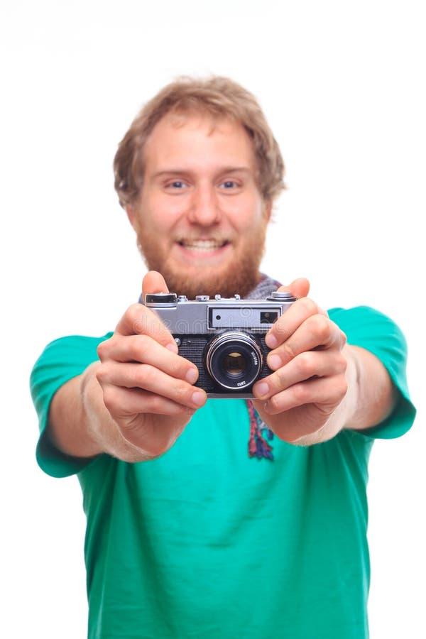 Porträt des netten Fotografen mit Kamera stockbilder