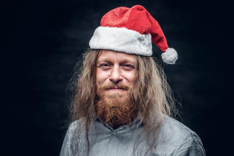 Porträt des traurigen bärtigen Mannes in Sankt-` s Hut stockbild