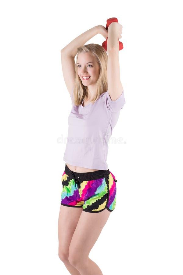 Porträt einer blonden Frau in den Sportkleidungstrainingshänden, -schultern und -rückseite mit den Dummköpfen stockfotografie
