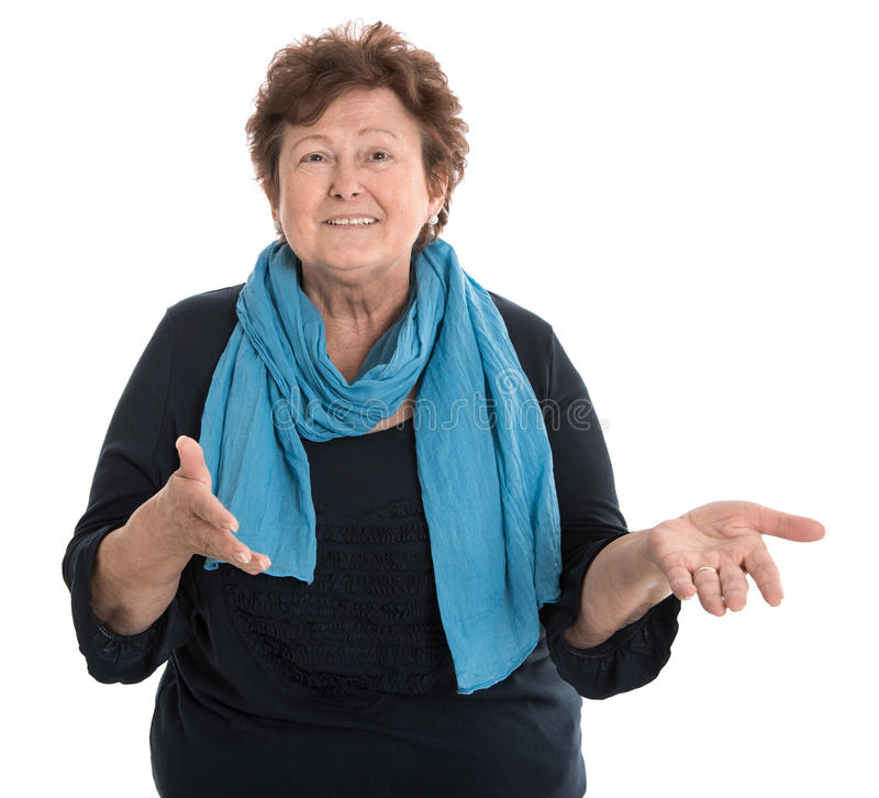 Porträt einer glücklichen lokalisierten weiblichen älteren Unterhaltung mit ihrer Hand lizenzfreie stockfotografie