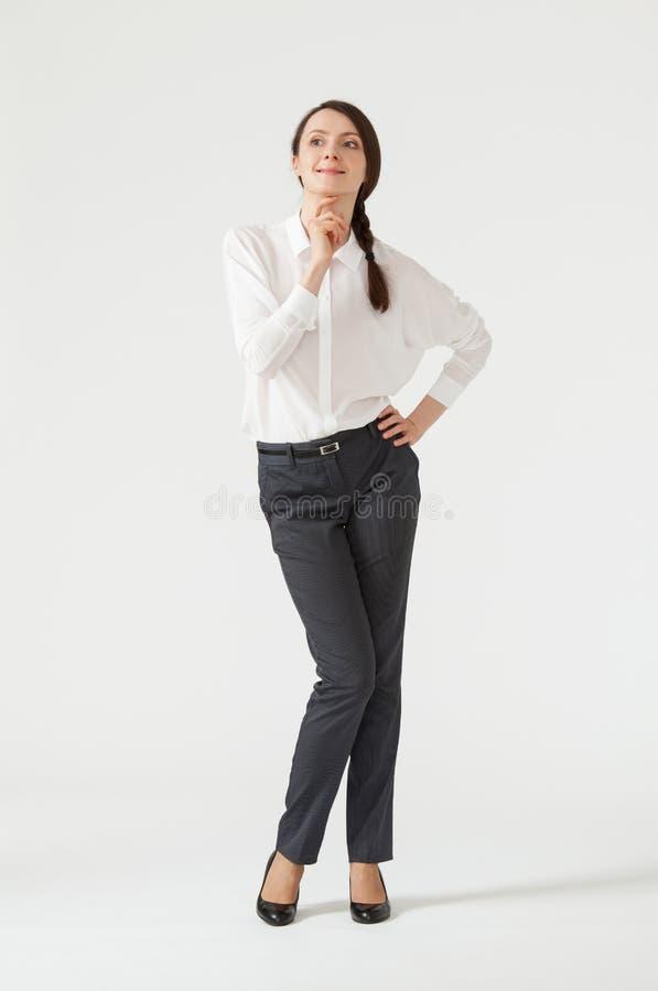 Porträt einer jungen nachdenklichen Geschäftsfrau lizenzfreie stockbilder