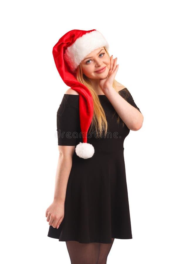 Porträt einer schönen jungen blonden Frau, die einen Sankt-Hut, lokalisiert auf weißem Hintergrund trägt stockfotos