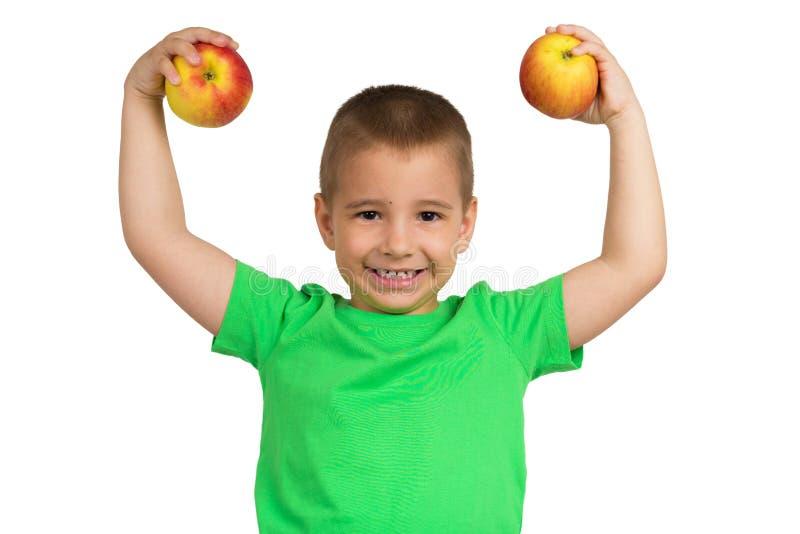 Porträt eines glücklichen Kindes mit Äpfeln in den Händen stockfotos