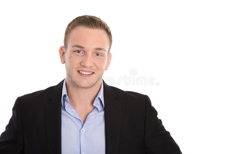 Porträt eines jungen blonden Geschäftsmannes in der Klage mit Sommersprossen lizenzfreie stockfotografie