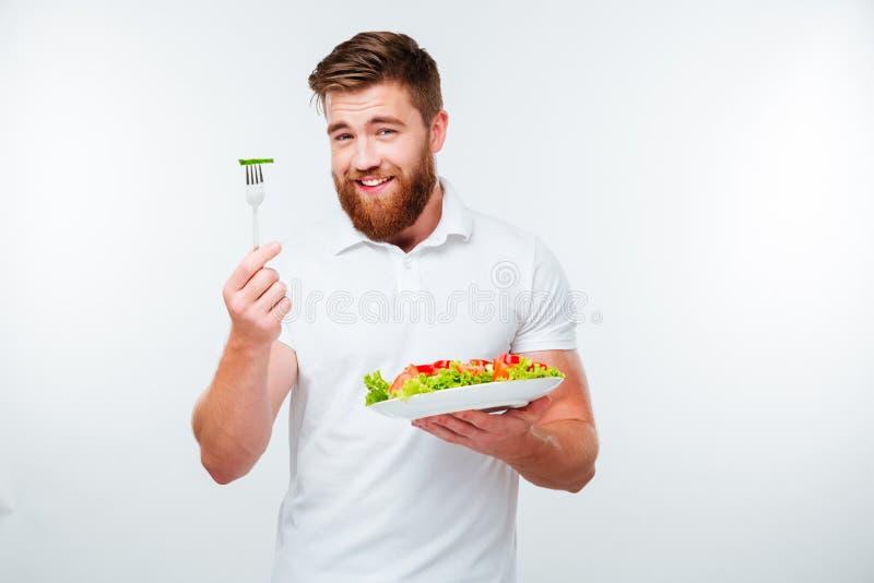 Porträt eines jungen hübschen zufälligen Fleisch fressenden Salats stockbilder