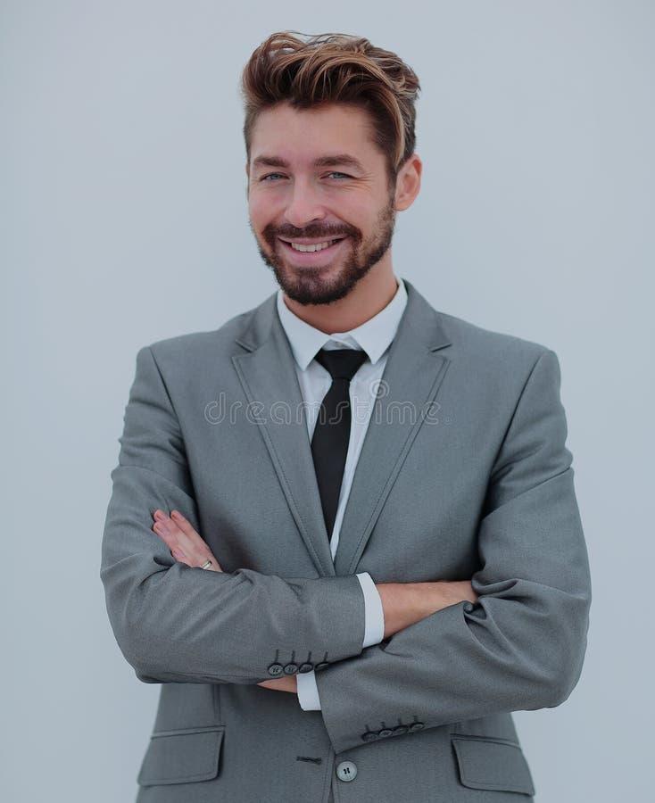 Porträt eines lächelnden hübschen Geschäftsmannes über weißem backgrou stockfotografie