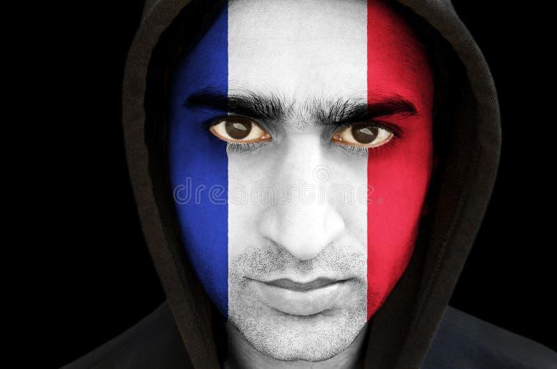 Porträt eines Mannes mit französischer Flaggengesichtsfarbe lizenzfreie stockfotos