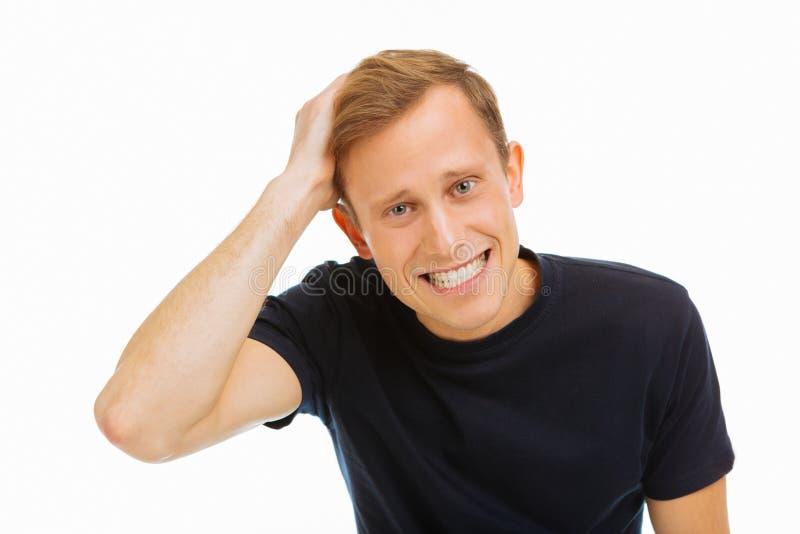 Porträt eines positiven blonden jungen Mannes stockfoto