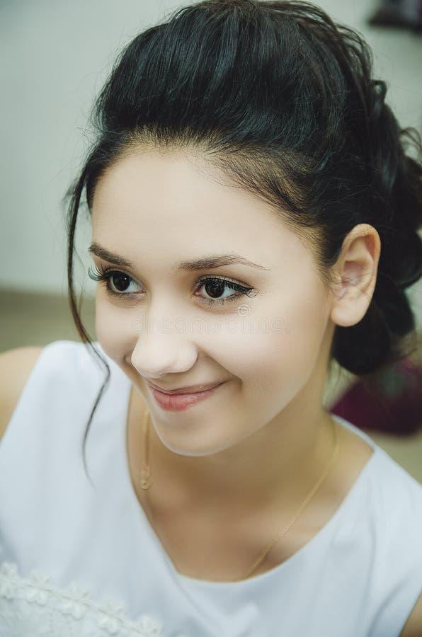Porträt eines schönen brunette Mädchens, Make-up, falsche Wimpern stockfoto