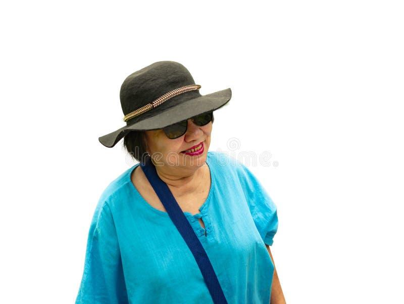 Porträt-Foto von touristischen asiatischen älteren Frauen auf lokalisiertem Hintergrund stockfotos