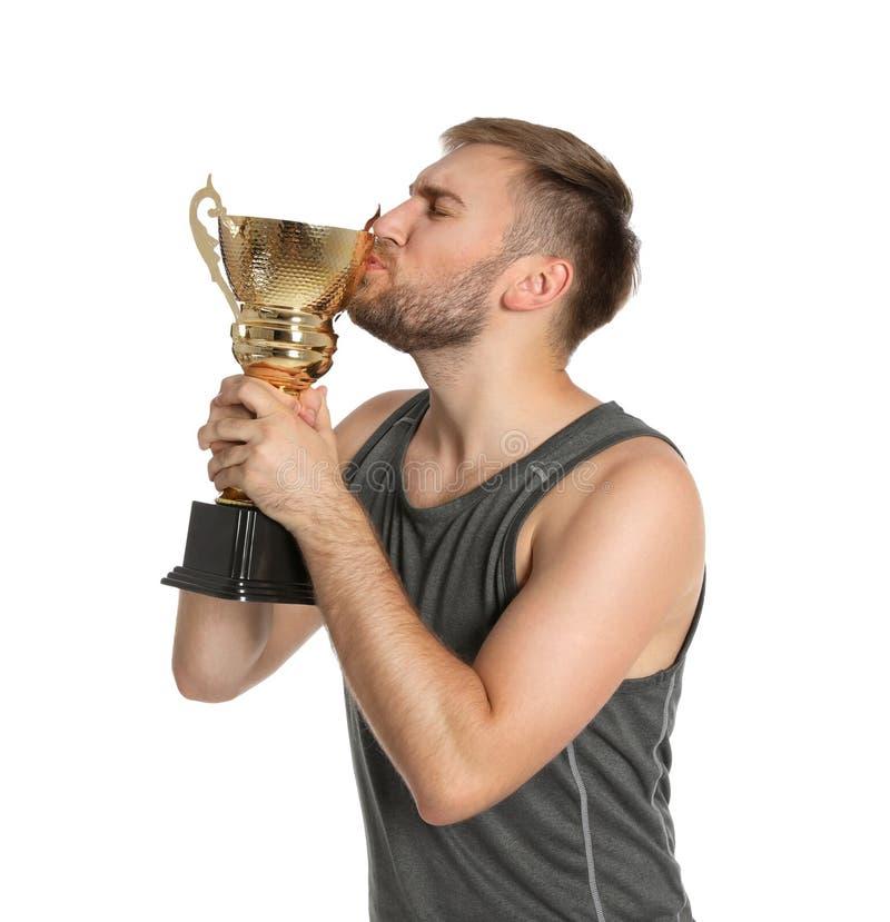 Porträt Trophäenschale des jungen Sportlers der küssenden Goldauf Weiß stockfotos