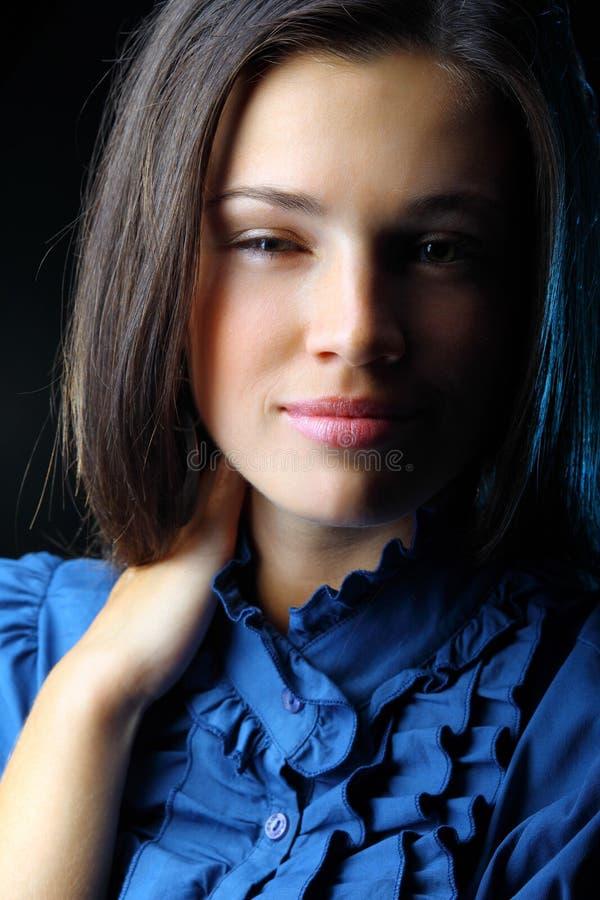 Porträt von eine glücklichen junge Frau Winks stockfoto